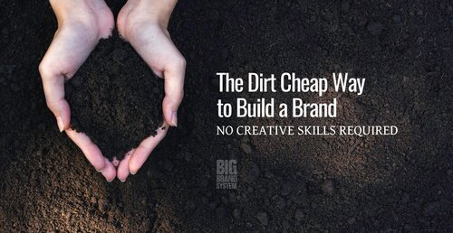 A pair of hands holding a handful of soil