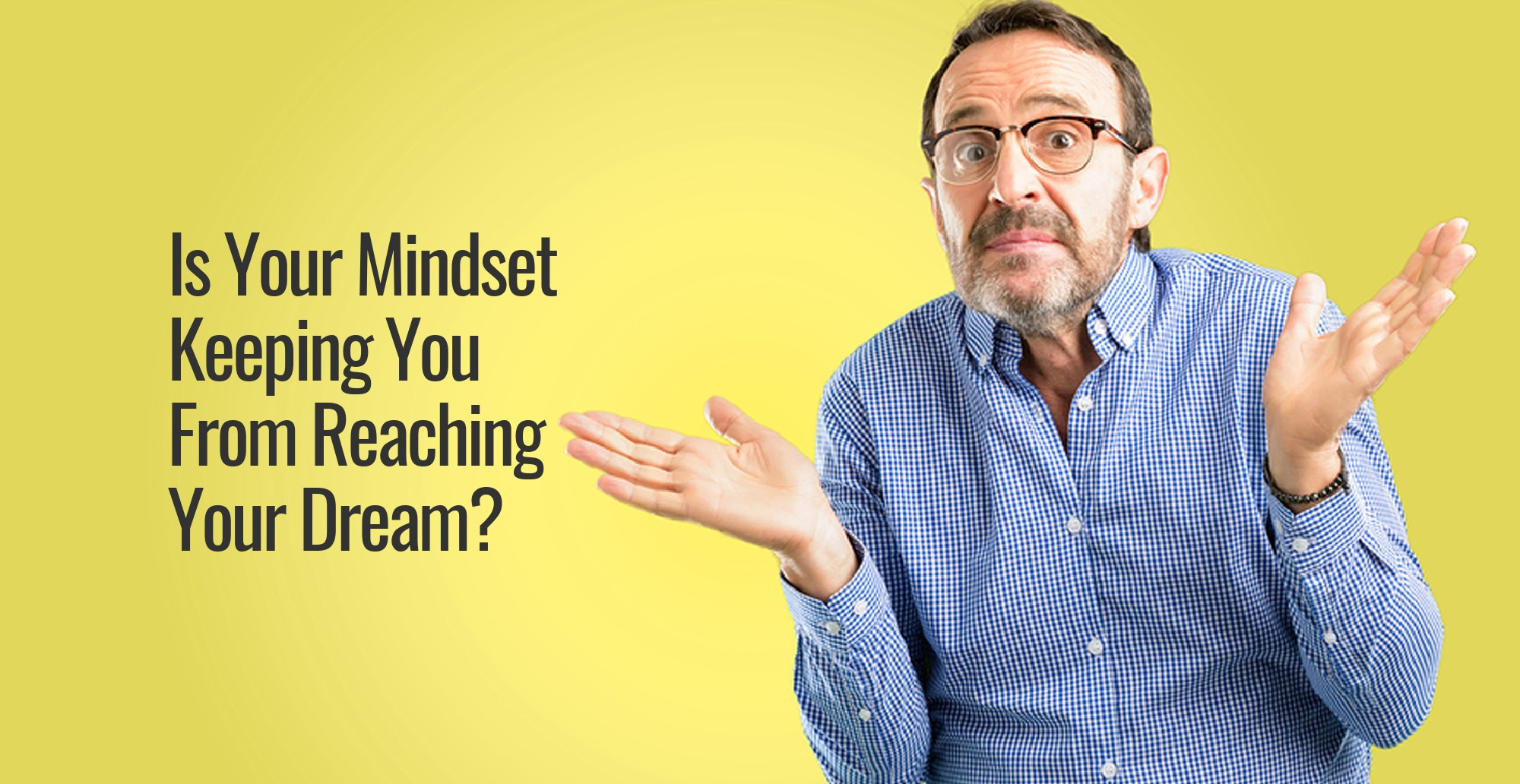 A man wearing glasses posing for the camera next to the words Is Your Mindset Keeping You From Reaching Your Dream?