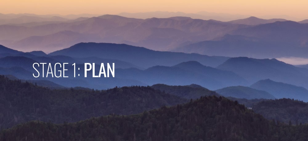 A large mountain in the background with the word PLAN