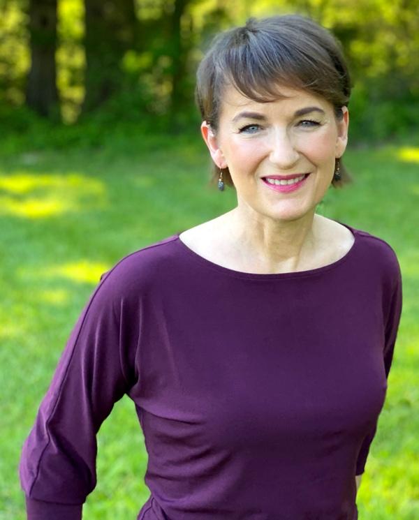 Pamela Wilson standing in the grass